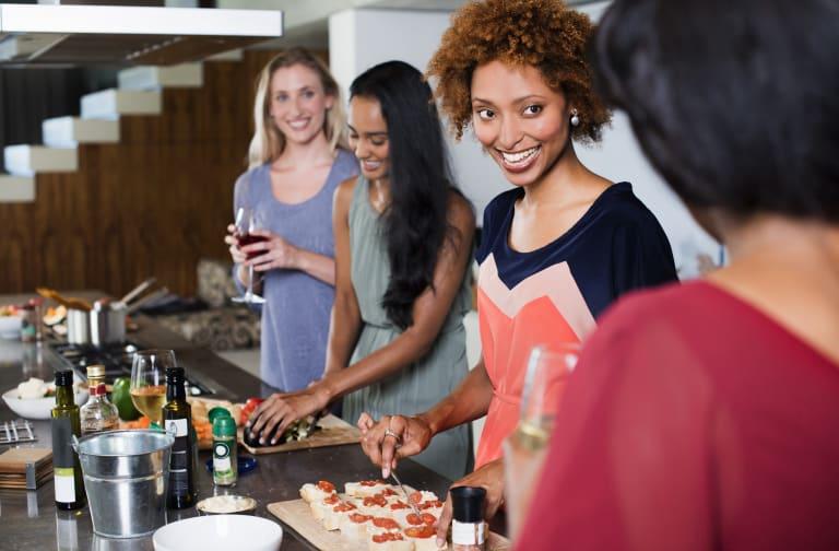 Female friends preparing food together