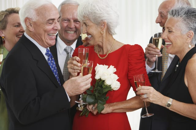 Senior friends drinking champagne at party