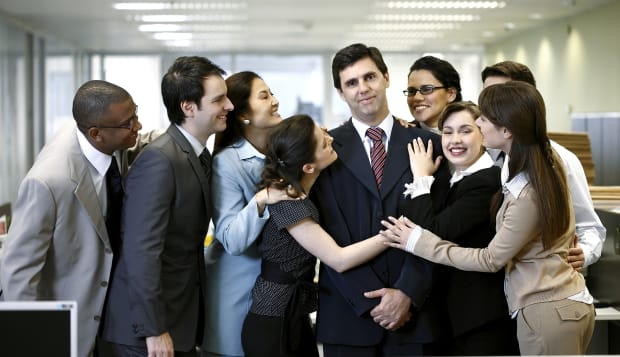 Executive people being nice with the boss