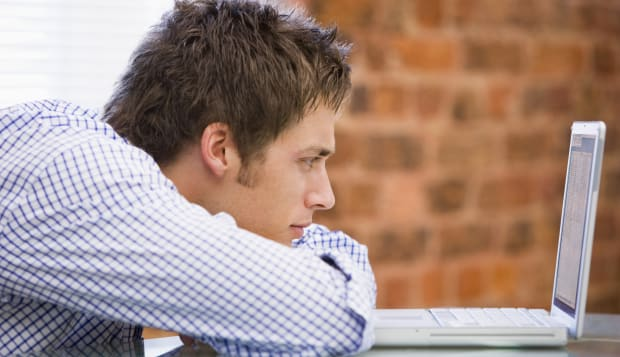 Man Studying Laptop In Office