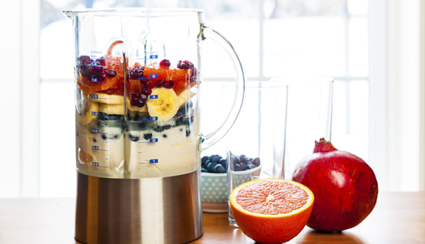 Preparing smoothies with fruit and yogurt
