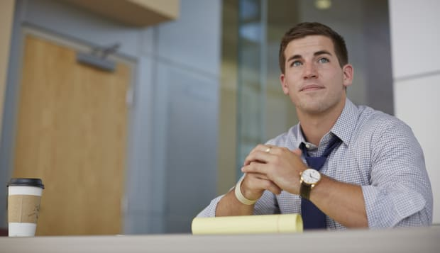 Caucasian businessman sitting in office