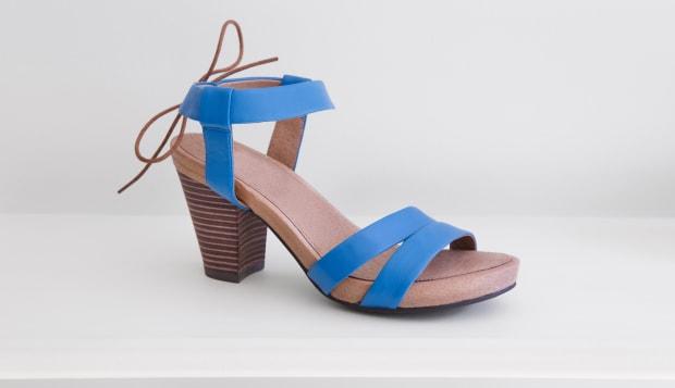 Blue ladies shoe on a white shelf