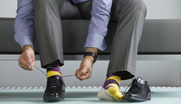 Man tying shoe laces