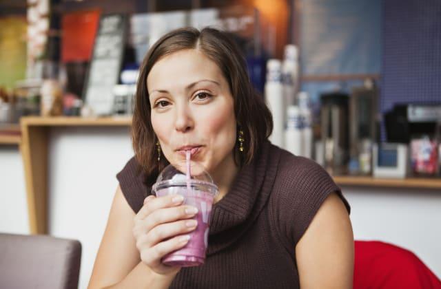 Women drinking smoothie during office break