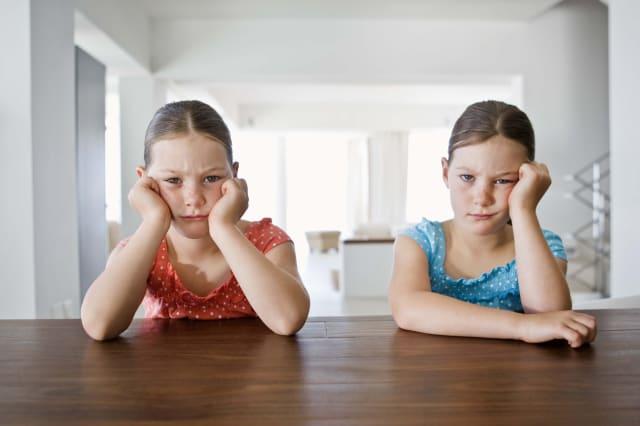 Bored twin girls