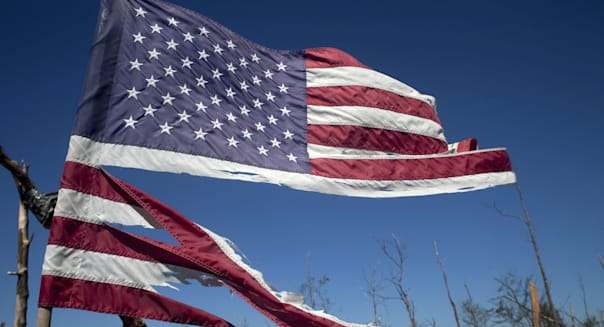 A tattered American flag flies over Alabama.