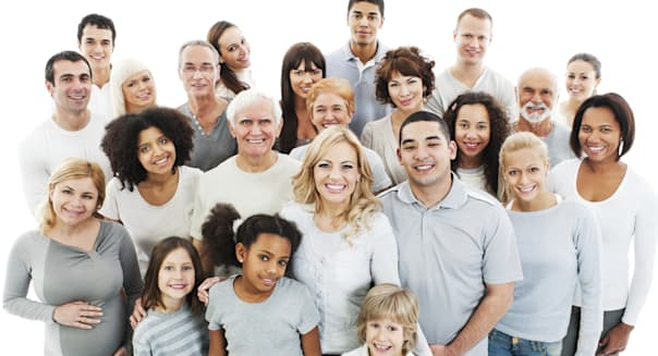 Portrait of a diversity Mixed Age and Multi-generation Family standing together. Isolated on white background.