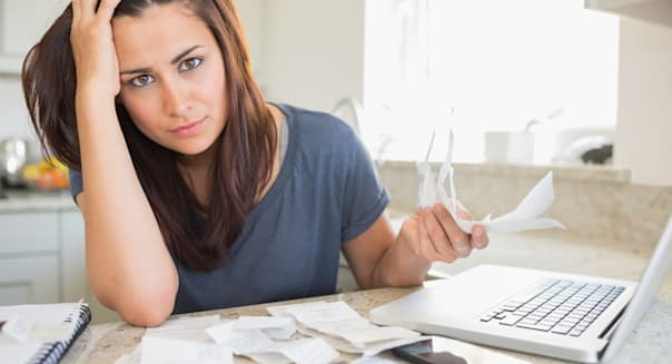 Young woman looking worried over finances