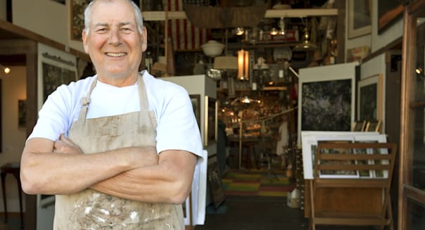 Antique business store owner smiling