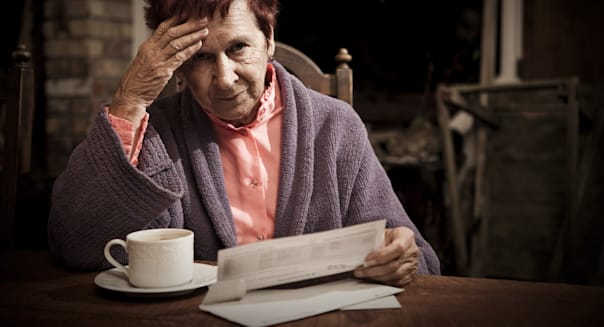 Distressed Senior Woman with Bills