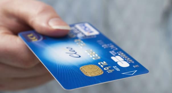 Close-up of woman's hand holding credit card