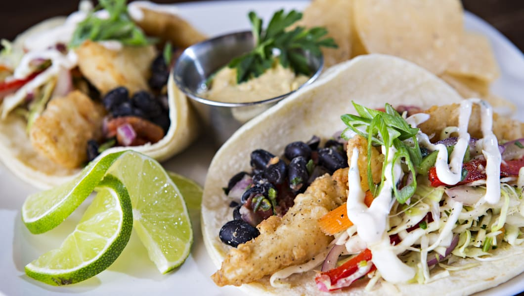 Plate Of Fish Tacos With Chips And Lime