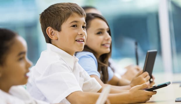 Private elementary school students using digital tablet technology in class