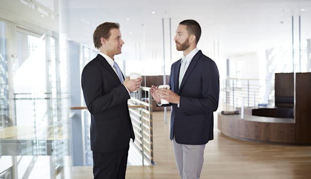 Business people having casual meeting with coffee
