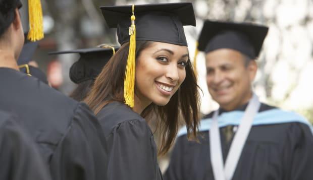Female graduate student at graduation ceremony, portrait