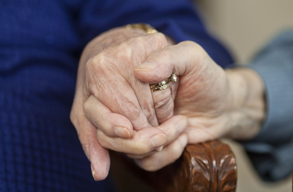 Hands of coupled married for over 50 years