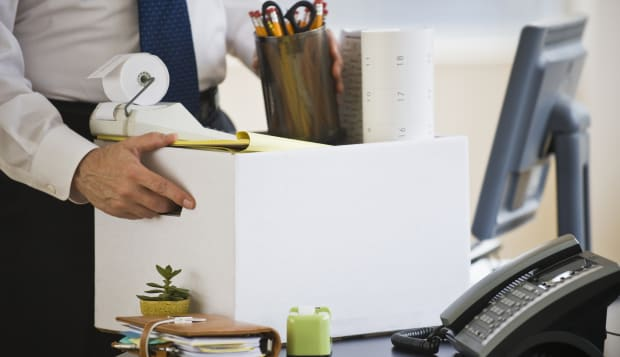 A businessman packing up desk