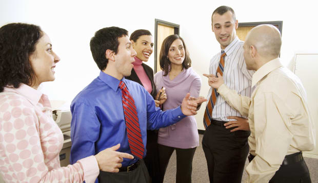 Group of co-workers talking in office