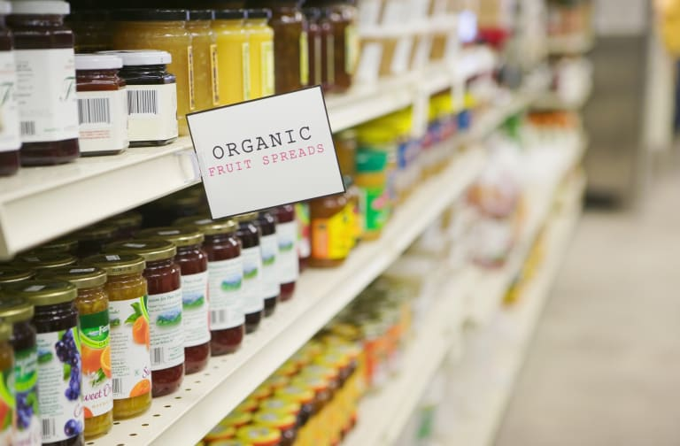Shelves of organic fruit spreads