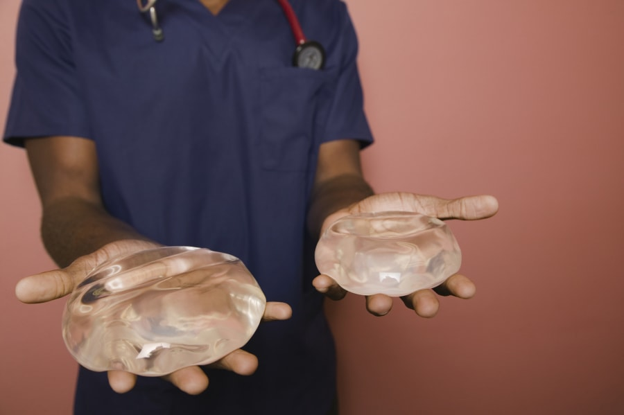 A surgeon holds a pair of