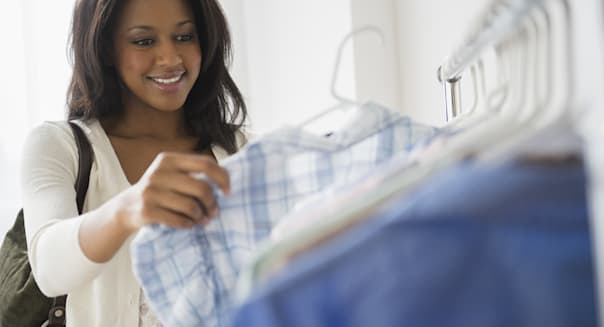 African American woman shopping for clothes