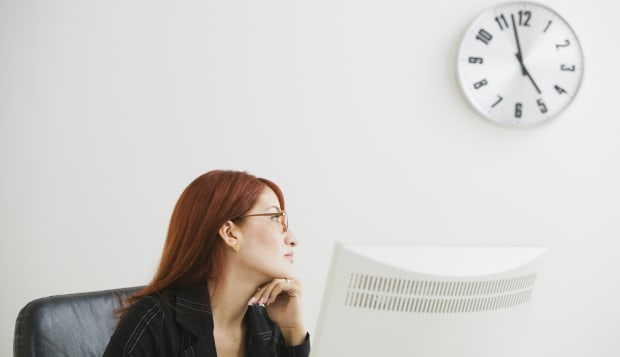 Businesswoman looking at clock