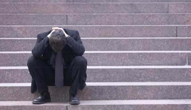 Stressed businessman on staircase