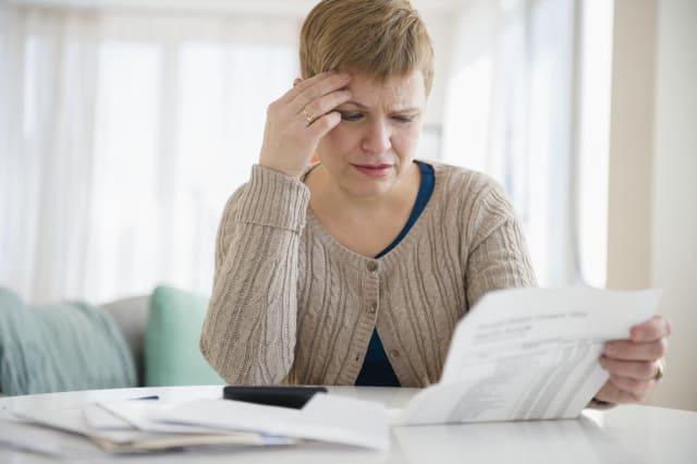 Anxious woman paying bills