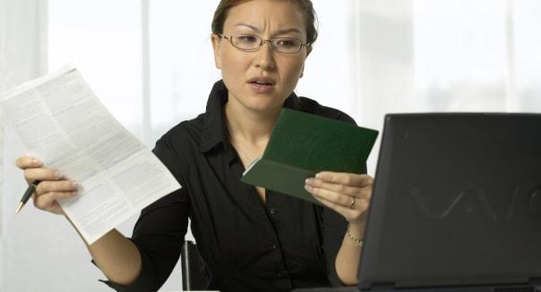 Asian woman paying bills
