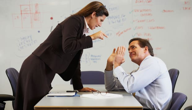 Businesswoman shouting at colleague
