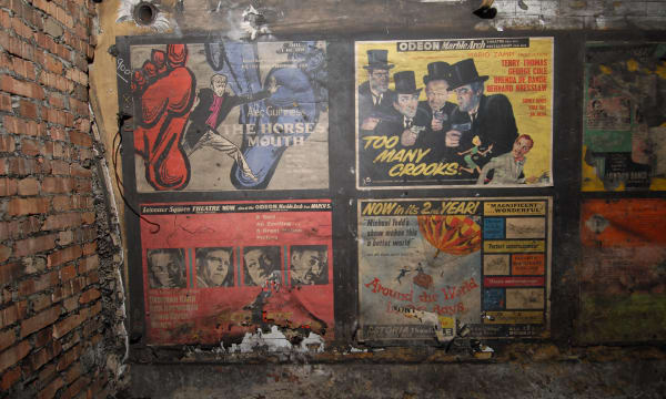 Abandoned Subway Stations Old film movie posters in disused area at Notting Hill Gate tube station, London - 2010