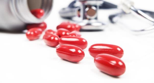 red pills spilled from a pill...