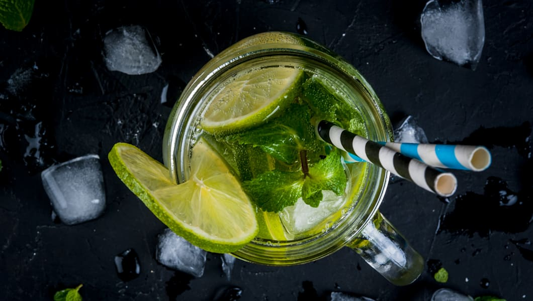Mojito with lime in a mason jar
