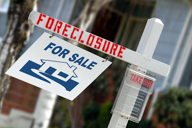 For Sale Real Estate Sign With Foreclosure Notice
