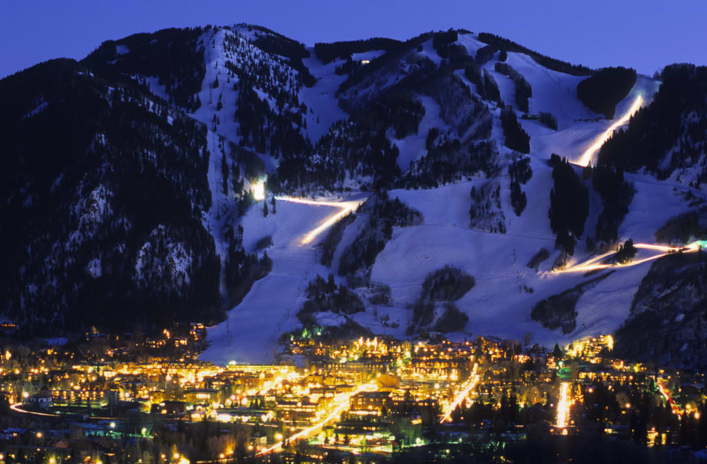 Ajax Mountain rises above the town of Aspen, Colorado at dusk.