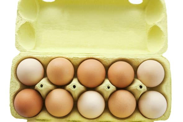 ten eggs in a open box on white, clipping path includet