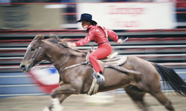SS05079.jpg  |color|horizontal|exterior|center|sport|animal|rodeo|cowgirl|horse|speed|determination|wild west|blur|riding|woman|