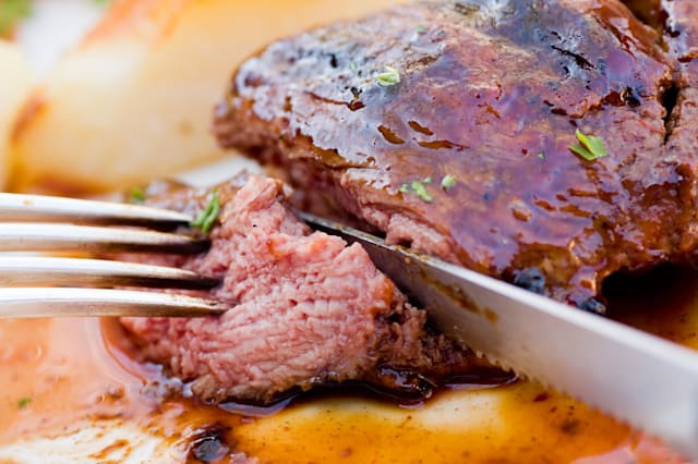 eating a steak.