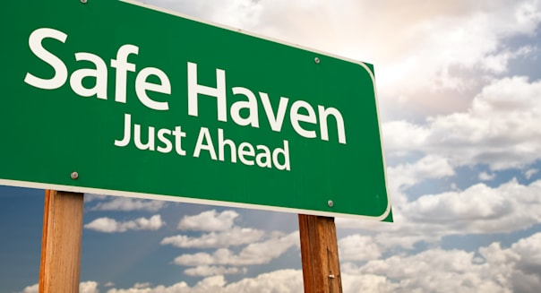 safe haven green road sign with ...