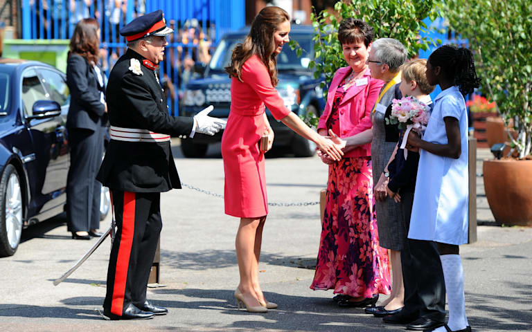 Kate dazzles in hot pink