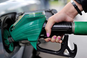 File photo dated 15/08/13 of a person using an Asda petrol pump as motorists are getting some new-year cheer, with supermarket Asda lowering its fuel prices and rivals expected to follow suit later. PRESS ASSOCIATION Photo. Issue date: Monday January 13, 2014. From tomorrow, Asda will be cutting the price of petrol and diesel by up to 2p a litre. The company said the new prices would mean motorists paying no more than 126.7p a litre for petrol and 133.7p a litre for diesel. See PA story TRANSPORT Petrol. Photo credit should read: Nick Ansell/PA Wire