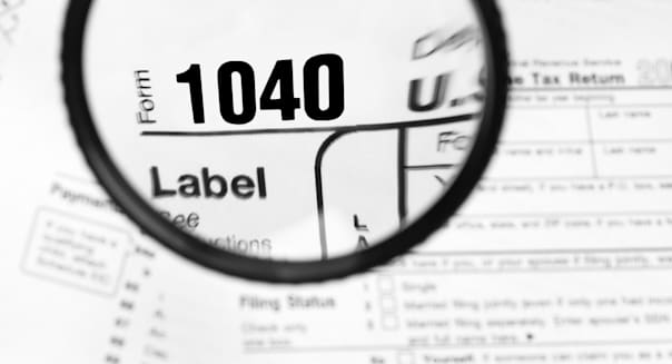 A magnified 1040 tax form for filing yearly income taxes