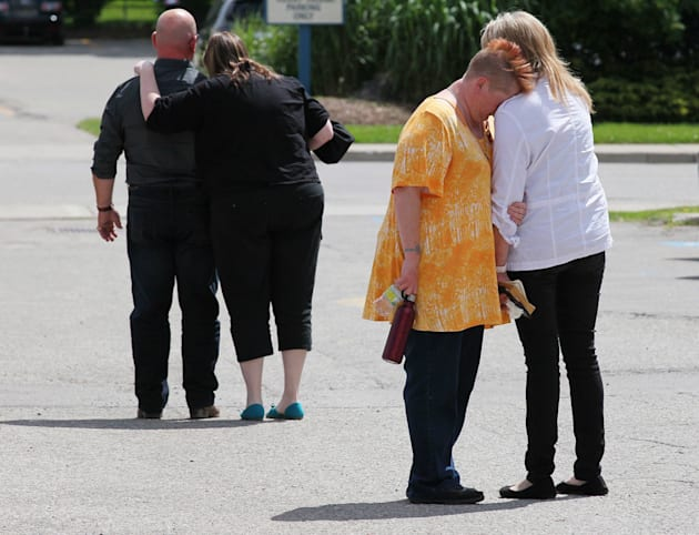 Family members lean on each other for support after reading their impact statements to the court at the...
