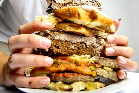 Studio shot of a hands holding a burger