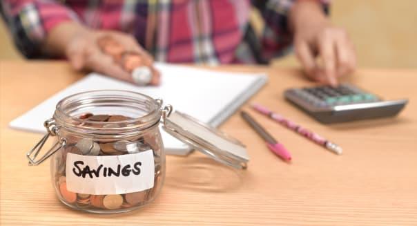 Teenager counting savings
