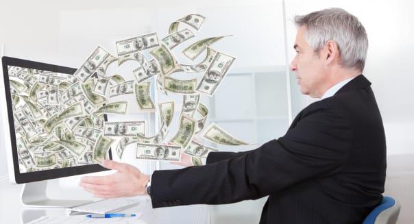 businessman earning lots of...