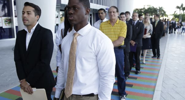 ADP (FILE - In this Wednesday, Oct. 23, 2013, file photo, Luis Mendez, 23, left, a student at Miami Dade College, left, and Maur