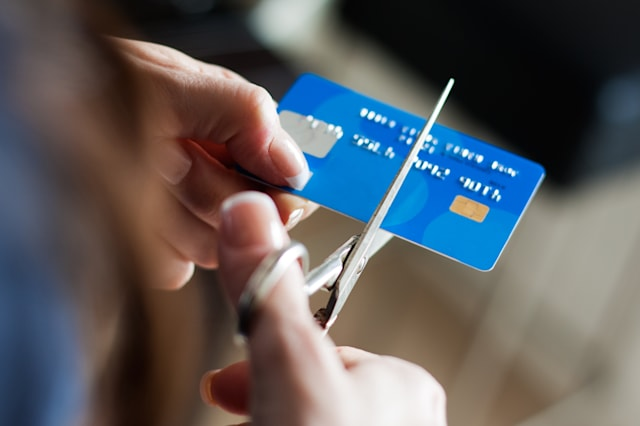 cutting up credit card with...
