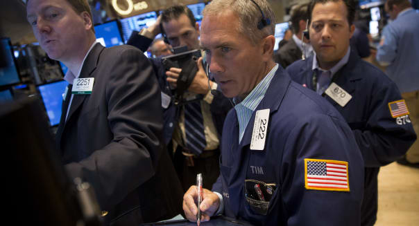 new york stock exchange traders wall street economy federal reserve stimulus